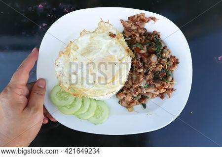 Stir Fried Pork With Holy Basil, Rice And Sunny Side Up Egg For Serve