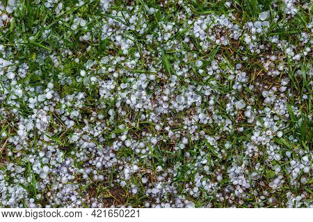 White Ice Hail On The Green Grass After Summer Storm