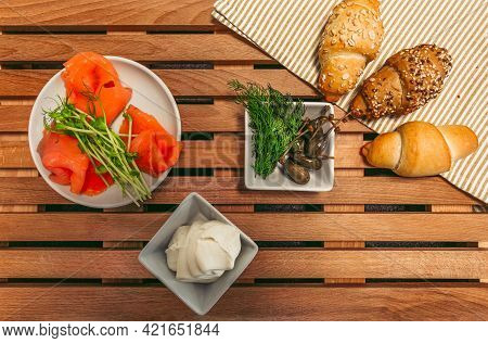 Lox, Croissants, Cream, Capers And Other Ingredients Prepared To Cooking - Top View. Traditional Fre