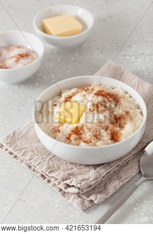 rice pudding with butter cinnamon. french riz au lait, norwegian risgrot, traditional breakfast dessert