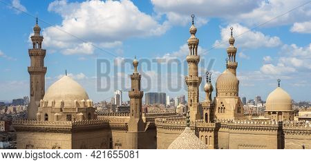 Aerial Day Shot Of Minarets And Domes Of Sultan Hasan Mosque And Al Rifai Mosque In Cloudy Day, Old