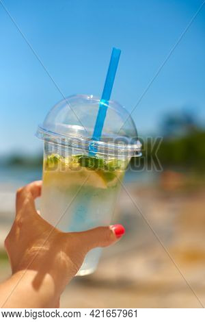 Woman Hand Hold Ice Fresh Summer Drink. Concept Quench Thirst. Shallow Depth Of Field Photo