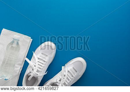 Sneakers With Water Bottle And Towel