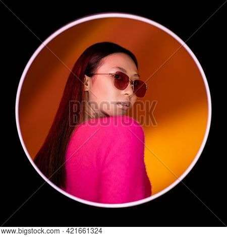 Color Light People. Fashion Portrait. Eyewear Accessories. Confident Glamour Neon Chinese Girl In Pi