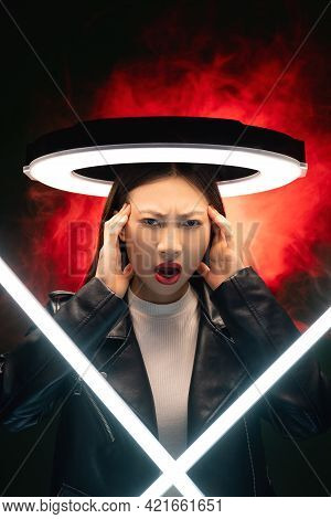 Anxiety Attack. Cyberpunk Portrait. Stress Frustration. Annoyed Asian Girl With White Halo Led Suffe