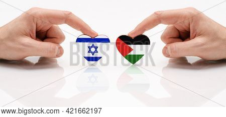 The Concept Of Friendship And Diplomatic Relations Between Israel And Palestine. Two Male Hands Are