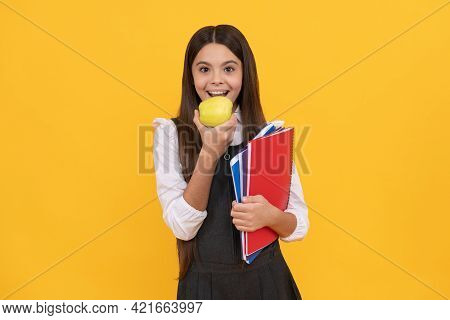Being Hungry For New Knowledge. Happy Schoolchild Eat Apple. Food Education. Nutrition Education