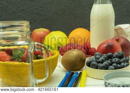 Fresh Fruit And Milk For Making A Milkshake. Ingredients For Making Strawberry Banana Smoothies. Fru