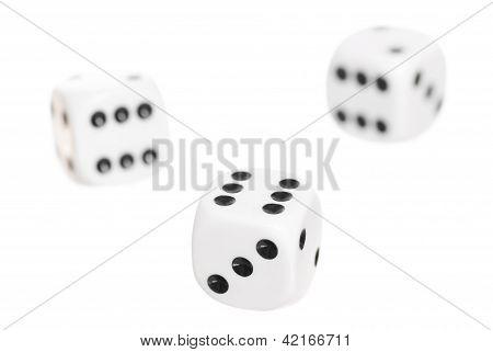 Three Falling Dice, White Background.