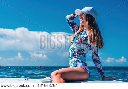 Healthy Happy Fit Woman In Bikini Relaxing On A Sup Surfboard, Floating On The Clear Turquoise Sea W