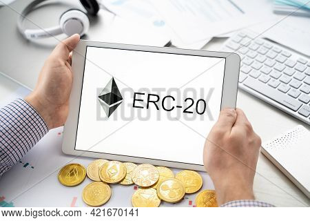 Russia Moscow 06.05.2021.businessman Holding Tablet With Logo Of Erc-20 Official Protocol Of Ethereu