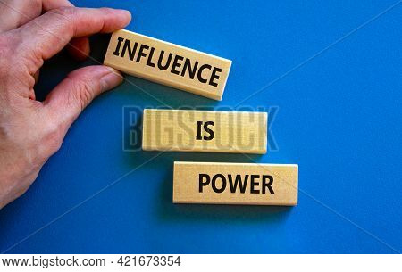 Influence Is Power Symbol. Wooden Blocks With Words 'influence Is Power'. Beautiful Blue Background,
