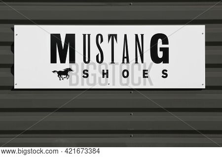Macon, France - March 15, 2020: Mustang Shoes Logo On A Wall. Founded In 1932, The Mustang Brand Is