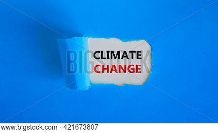 Climate Change Symbol. Words 'climate Change' Appearing Behind Torn Blue Paper. Beautiful Blue Backg