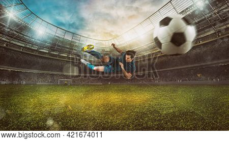 Soccer Striker Hits The Ball With An Acrobatic Kick In The Air At The Stadium
