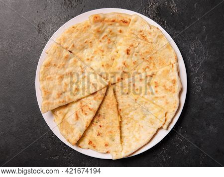 Caucasian Flatbreads, Tortillas  With Cheese On A Dark  Background, Top View