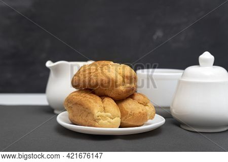 Homemade Profiteroles On Table On Gray Background. Puffs, Popovers. Traditional French Eclairs.
