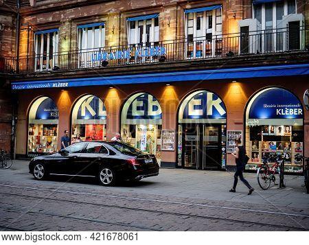 Strasbourg, France - May 24, 2017: Librairie Kleber In Central Strasbourg With Luxury Mercedes-benz
