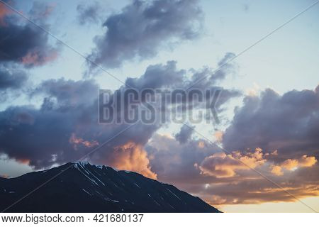 Atmospheric Mountain Scenery With Lilac Dawn Sky. Scenic Landscape With Illuminating Sunset In Mount