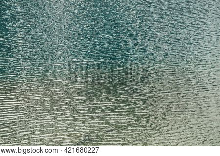 Texture Of Green Blue Calm Water Of Lake. Meditative Ripples On Water Surface. Nature Minimal Backgr