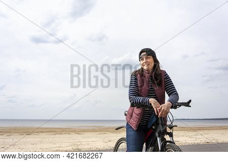 A Woman On A Bicycle, Ride A Bicycle, A Bike Path And A Young Pretty Woman With A Bicycle, A Europea