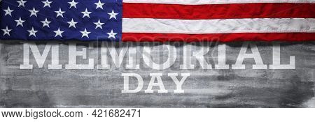 US American flag over Memorial Day Text. Wallpaper for USA Memorial Day.