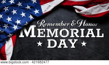 US American flag over Remember and Honor Memorial Day Text. Wallpaper for USA Memorial Day.