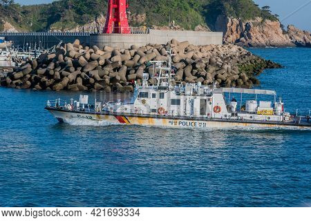 Sinjindo, South Korea; May 5, 2021: Starboard View Of Korean Police Frigate Coming Into Seaport Pass
