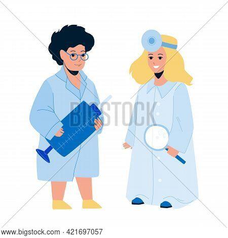 Children Doctors Boy And Girl Play Together Vector. Children Doctors In Medical Uniform Holding Syri