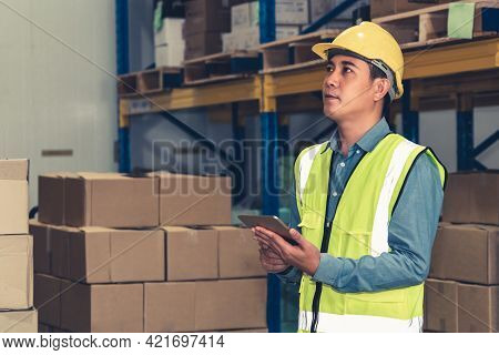 Asian Warehouse Worker Checking Packages In Storehouse . Logistics , Supply Chain And Warehouse Busi