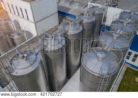 Stainless Steel Tanks At A Food Processing Plant Top View.