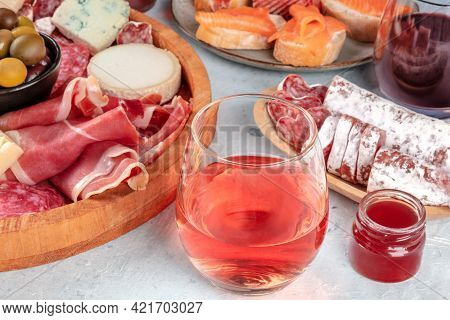 Rose Wine With Charcuterie, Cheese, And Salmon Sandwiches. Spanish Tapas. Jamon, Fuet, Goat And Blue