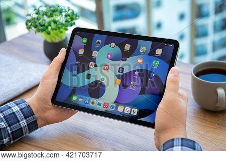 Alanya, Turkey - May 14, 2021: Man Hand Holding Ipad Air Ios 14 With Widget On The Home Screen. Ipad