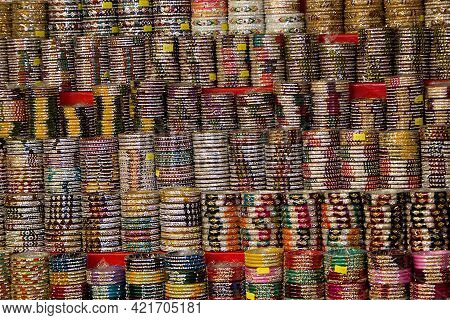 Beautifully Stacked, Neatly Arranged Rows Of Colourful Bangles In Fancy Store