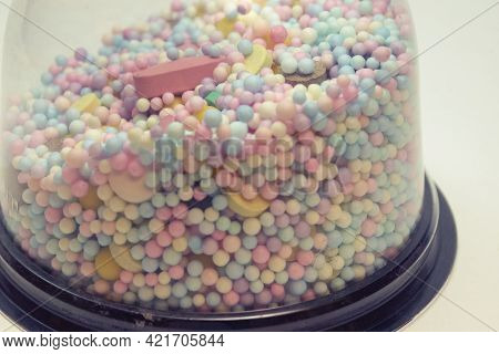 Medicine Pills, Tablets And Multicolored Small Round Vitamin Dragees Closeup Under Plastic Transpare