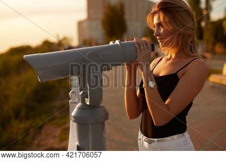 Adult Female In Casual Clothes Admiring Nature Through Telescope While Resting On Viewpoint At Sundo