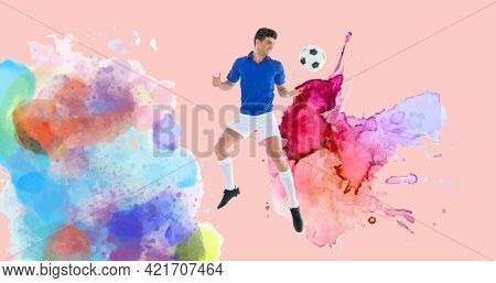 Composition of football player with ball over colourful splodges and pink background. sports event and competition concept digitally generated image.