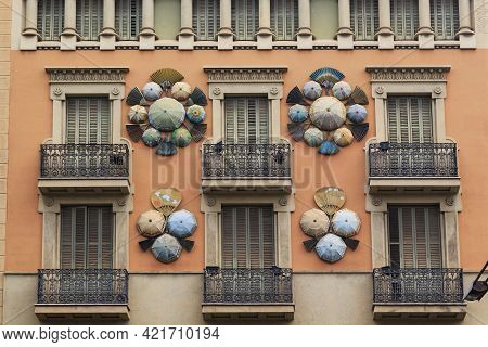 Barcelona, Spain - May 10, 2017: This Is A Fragment Of The Facade Of The House With Umbrellas, One O