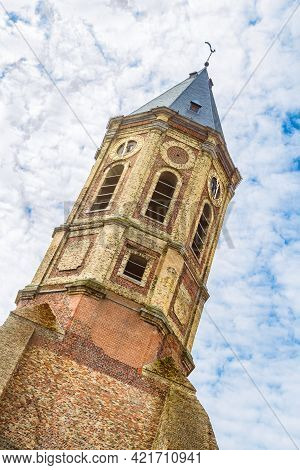 Peperbusse.  Medieval Tower Of Burned Down St Peter Church. Church Tower With Golden Clock On The Fa