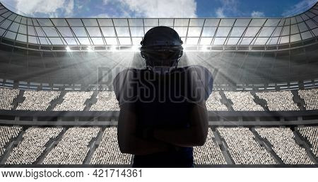 Composition of portrait of american football player on sports stadium. sport and competition concept digitally generated image.