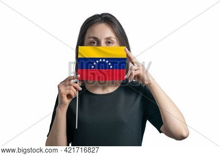 Happy Young White Woman Holding Flag Venezuela Flag And Covers Her Face With It Isolated On A White