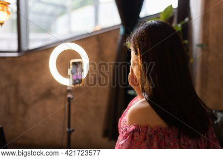 Young Woman Making Photo Or Video Content For Social Media With Smartphone And Light Of Ring Lamp. B