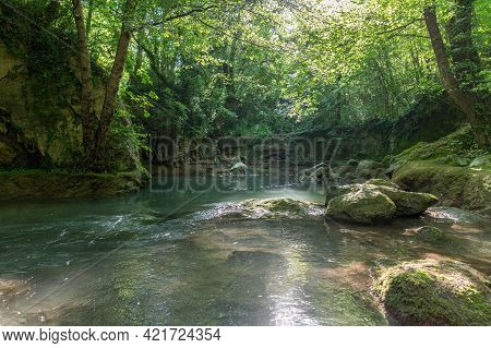 River In The Woods Coming From The Waterfall Of The Marmore
