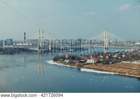 St. Petersburg Cityscape With A Cable-stayed Bridge Over A Wide Winding River