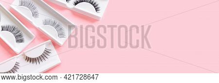 Different Fake Eyelashes On Trendy Pastel Pink Background. Beauty Pattern. Makeup Accessories. Cosme