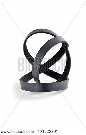 A New Belt For A Poly-v-ribbed Electric Generator. Car Timing Belt. White Background Close-up. Selec