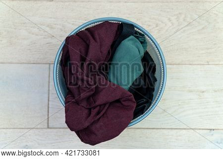 Clothes In Trash Can. Sorting And Processing Waste. Garbage Sorting. Recycling. The Trash Can Is Com