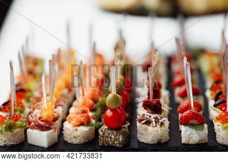 Delicious Appetizers And Canapes On Table At Wedding Reception In The Restaurant. Luxury Catering Se