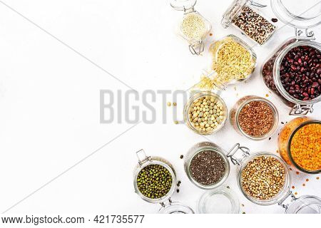 Plastic Free Storage And Cooking Concept. Various Organic Superfoods, Beans, Grains, Cereals, Legume