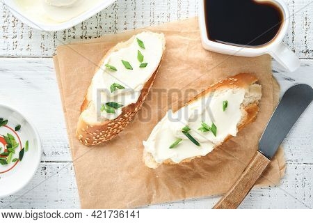 Sandwich With Soft Cheese With Green Onions And Bread On Old White Wooden Background. Simple Breakfa